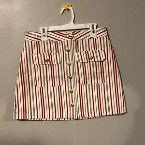Red, white, black striped skirt with gold buttons.